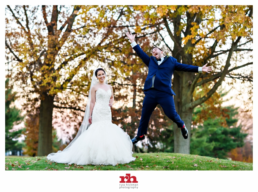 A Newly Married couple jump for joy right after their Bucks County Wedding at Northampton Valley Country Club.