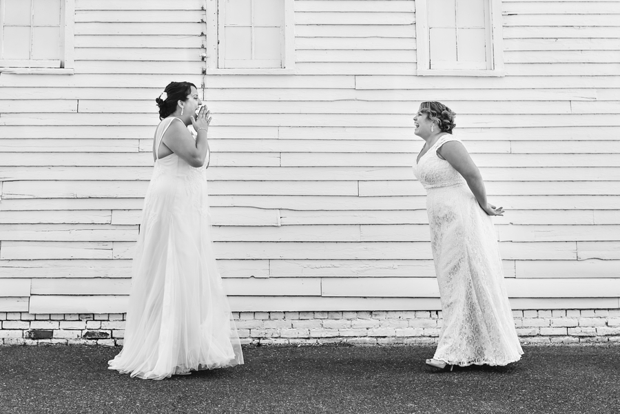 Two brides see each other for the first time in their first at their same sex wedding in NJ.