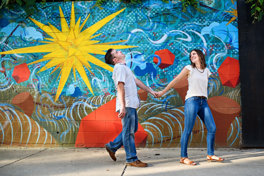 A fun engaged couple take a walk in the Fishtown neighborhood of Philadelphia.