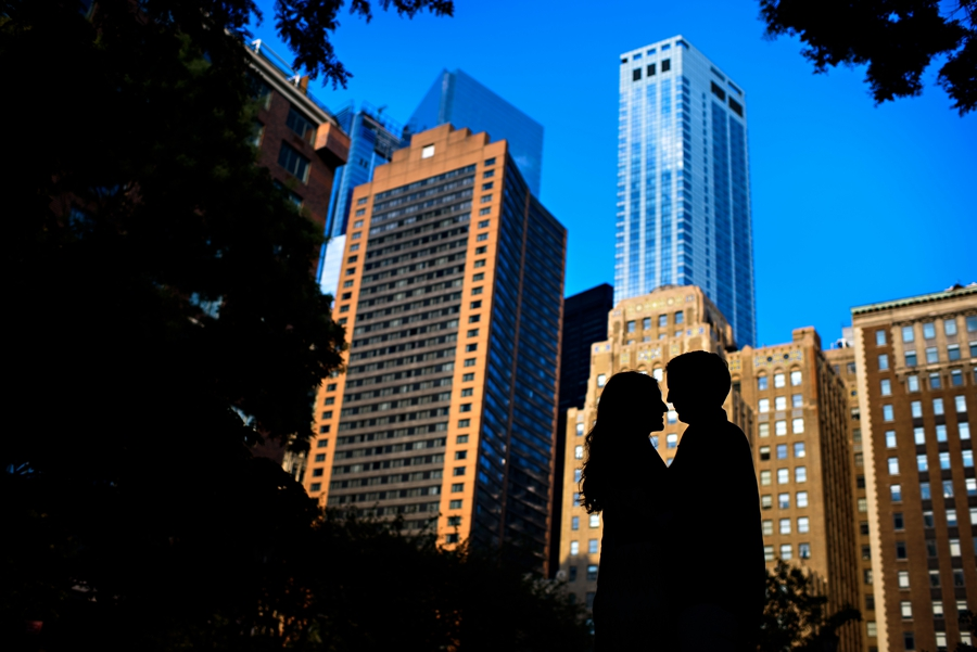 A silhouette of a couple on their engagement session in Battery Park NYC.