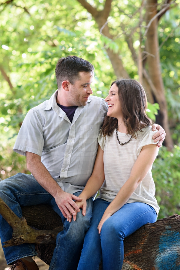 A Bride to be looks at her fiance with love in their penn treaty park engagement session.
