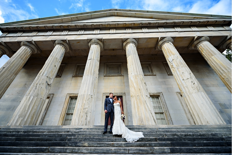 A bride and groom on the steps of the 2nd Bank of the United States in Philadelphia.