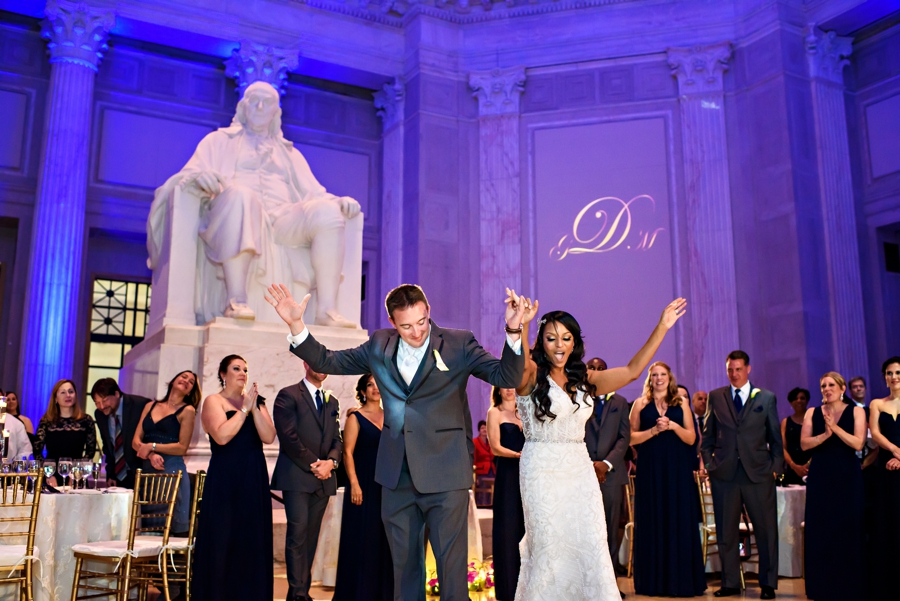 A newly married couple share their first dance at their reception at The Franklin Institute in Philadelphia.