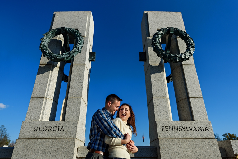 A Navy Couple hug inbetween their home states at the WWII Memorial in thier DC engagement Session.